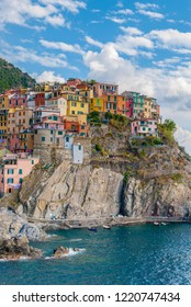 View of Manarola, one of the villages of the Cinque Terre National Park, La Spezia Province, Liguria region, coast of the Gulf of Genoa. Terraces of small colored houses on a cliff above the sea