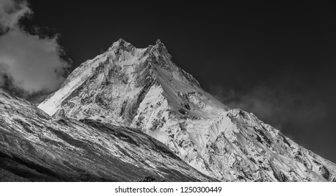 View of Manaslu mountain Main Summit and its East Pinnacle peak, as seen from the  trail  to Samagaon village, Manaslu Circuit trek, Gorkha district, Nepal Himalayas, Nepal