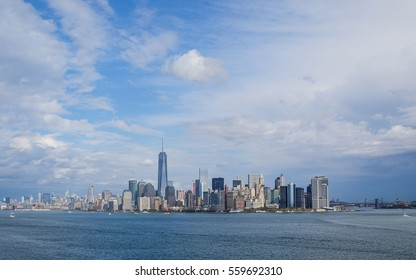 view of Manhattan with freedom tower and river