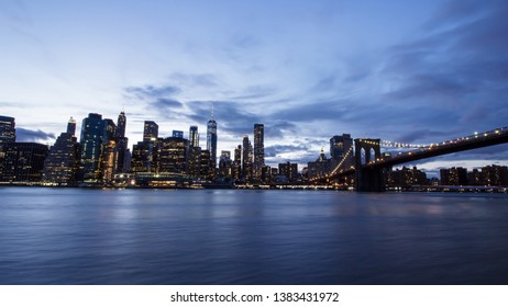 View of Manhattan skyline with Brooklyn Bridge at night