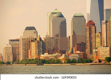 View of the Manhattan skyline at sunset, taken from the Staten Island ferry, as it crosses the Hudson River, New York