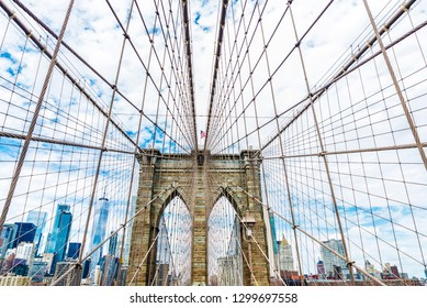 View of Manhattan skyscrapers from the Brooklyn Bridge in New York City, USA
