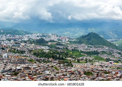 View of Manizales, Colombia with lush green hills in the background