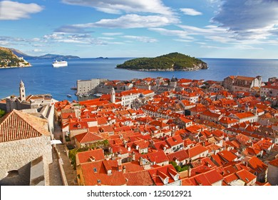 View of many landmarks of Old town in city of Dubrovnik, Croatia. Classic red tiled rooftops with Adriatic sea and island also are beautiful.
