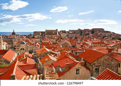 View of many landmarks of Old town in city of Dubrovnik, Croatia. Classic red tiled rooftops with Adriatic sea also are beautiful.
