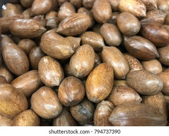 View of many pecan nuts with their peel