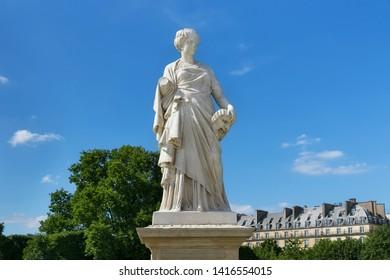 View of the marble sculpture La Comedie (1875) by Julien Toussaint Roux in the Tuileries Park, Paris, France.