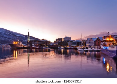 View of a marina in Tromso, North Norway. Tromso City Waterfront at Night