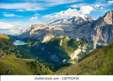 View to Marmolada and Fedaia Lake. Marmolada is the highest mountain of Dolomites, situated in northeast Italy