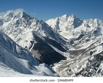 A view up the Maroon Creek Valley seen from the top of Aspen Highlands.  On display are three of Colorado's fourteeners: (L to R) Pyramid Peak, South and North Maroon Peak.