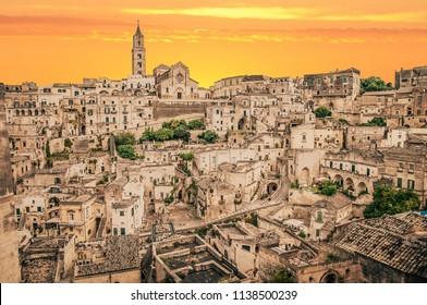 view of Matera at sunset, view of Matera at golden hour, Rays of light in Matera at sunset, Matera at sunset, orange lights
