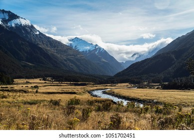 View of Matukituki Valley, in Mount Aspiring National Park. Traveling, Hiking and Camping in New Zealand. Snow topped mountains, clear waters, and green valleys.