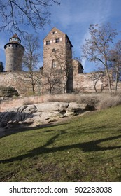 View of the meadow, walls and towers of the Imperial Castle of Nuremberg, Germany
