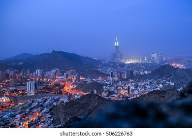"A view of Mecca landmark the Clock tower and grand mosque Masjidlharam during the dawn fajr from the Mount of light ""Jabal An-Nour"" where located the Hira cave"