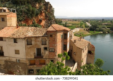 View of medieval buildings in Miravet, Catalonia, Spain above Ebro River
