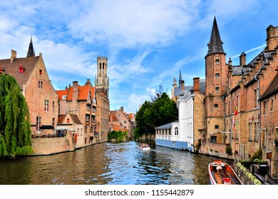 View of the medieval canals of Bruges, Belgium with famous bell tower