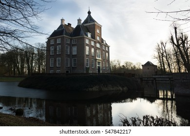 View of medieval castle Soelen in the evening illuminated by the evening sun in wintertime Betuwe Netherlands Holland
