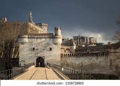 View of medieval city walls of Avignon from the Pont d` Avignon, France. Layers of crenelated city walls and buildings of Avignon. Taken from the Pont d`Avignon, famous for song Sur Le Pont d`Avignon.