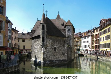 View of the medieval Palais de l'Île museum, called also Old Prisons located in the middle of the Thiou river and surrounded by the nice and coloured palaces in the French city of Annecy, departement