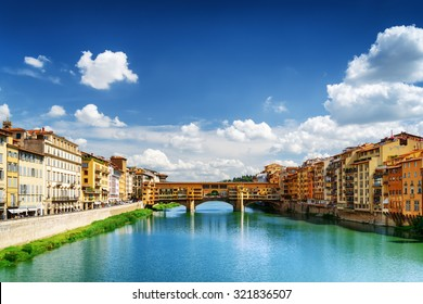 View of medieval stone bridge Ponte Vecchio and the Arno River from the Ponte Santa Trinita (Holy Trinity Bridge) in Florence, Tuscany, Italy. Florence is a popular tourist destination of Europe.