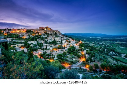 View of the medieval town of Gordes at dusk, Luberon, South of France.