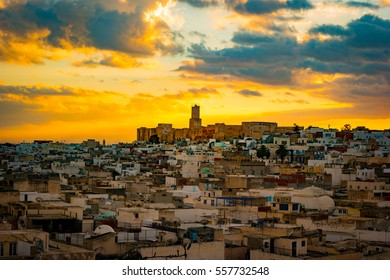 View of the Medina and the castle kasbah in Sousse, Tunisia. Cityscape of Sousse at dramatic sunset with red skies and clouds.