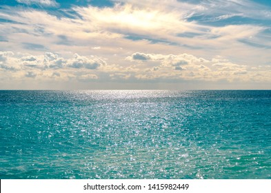 View of the Mediterranean Sea with the sun glistening on the horizon, at Nice, France