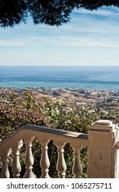 A view to the Mediterranean Sea from a village of Mijas in Andalusia, Spain. The railing seems to be pretty old.