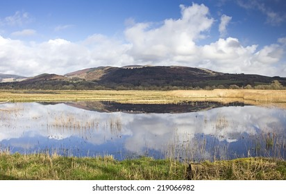 View from the Meida hide with stunning reflections at RSPB Mersehead Nature Reserve, Southwick, Dumfries and Galloway, Scotland, UK.