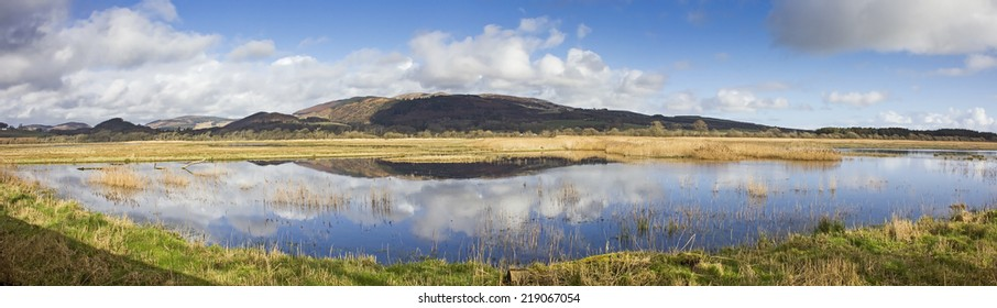 View from the Meida hide with stunning reflections, in panoramic format, at RSPB Mersehead Nature Reserve, Southwick, Dumfries and Galloway, Scotland, UK.