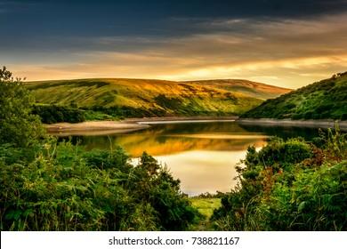 A view of Meldon reservoir during a quiet summer evening in Dartmoor, England