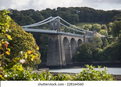 A view of the Menai suspension bridge over the Menai Straits, Anglesey, Wales, UK.