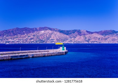 View of Messina port in Sicily island. Messina harbor and coastline at the background Sicily island, Italy.