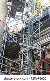 View of metal scaffolding installation at process equipment structures.