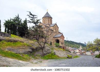 View Metekhi Church in the morning above the Kura river in Tbili