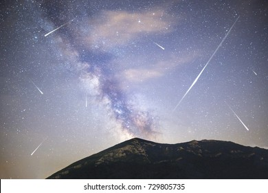 A view of a Meteor Shower and the Milky Way with a mountain top in the foreground. Night sky nature summer landscape. Perseid Meteor Shower observation. Rtanj mountain in Serbia.