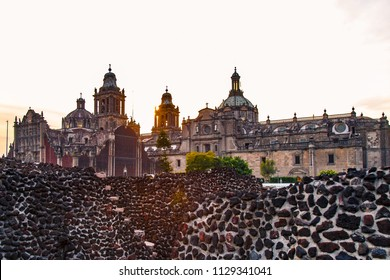 View of The Metropolitan Cathedral of the Assumption of the Most Blessed Virgin Mary into Heavens from the Templo Mayor ruins, Mexico city.