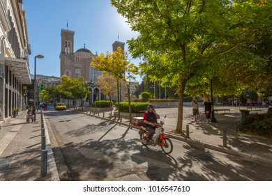 View of Metropolitan Cathedral of Athens and motor cyclist in Metropolis Square, Athens, Greece, Europe 12 October 2017