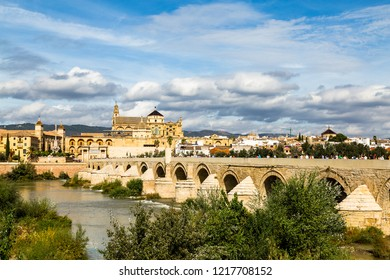 View of Mezquita, Catedral de Cordoba, across the roman bridge on Guadalquivir river. A former Moorish Mosque that is now the Cathedral of Cordoba, Mezquita is a UNESCO World Heritage Site.
