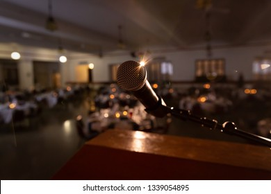 View of microphone on stage facing empty auditorium