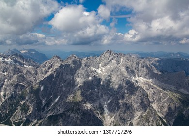 View from the Middle peak of the Watzmann over the Wimbachgries valley to the opposing mountain ridge where dramatic clouds throw their shadows on the steep rocks