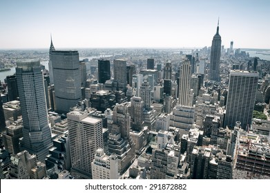 View of Midtown Manhattan New York City skyline on bright summer afternoon