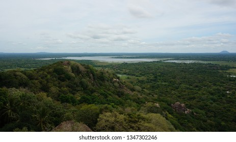 View from Mihintale temple to the countryside with forest, paddy fields and ancient artificial basins