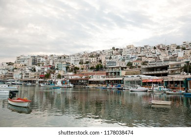 View of Mikrolimano Port in Piraeus, near Athens, Greece, at sunset.