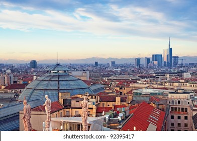 View of Milan from the rooftop of  Duomo di Milano. Statues of  Duomo of Milan, Galleria Vittorio Emanuele II and skycrapert of Porta Nouva also visible.
