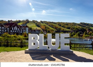 View of Mill pond and and BLUE sign, Blue Mountains Village, Ontario, Canada