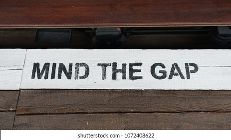 View of a 'Mind the Gap' Notice on a Train Station Platform