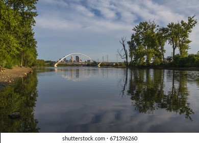View of the Minneapolis skyline framed up by the Lowry Bridge over the Mississippi. The island on the right is the home to a large rookery of Great Blue Heron nests.