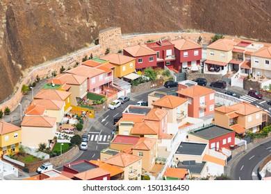 View from Mirador de la Concepcion to colorful houses in the crater village La Caldereta in Santa Cruz de la Palma, Spain.