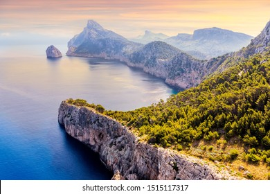 View from the Mirador Es Colomer towards the island Colomer and the mountain range on Formentor peninsula, beautiful sunset, Mallorca, Spain